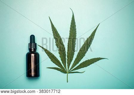 Cannabis Oil (cannabidiol).  Medical Cannabis (marijuana) And Extract On Blue Background.