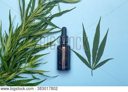 Cannabis Oil (cannabidiol).  Medical Cannabis (marijuana) And Extract Cbd On Blue Background.
