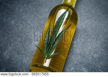 Cannabis Oil (cannabidiol).  Medical Cannabis (marijuana) And Extract Cbd On Dark Background.