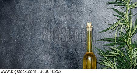 Cannabis Oil (cannabidiol).  Medical Cannabis (marijuana) And Extract Cbd On Dark Banner Background.