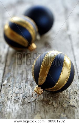 three christmas ornaments in gold and blue