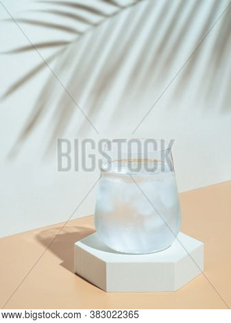 Cold Water With Ice In Tumbler Glass On Hexagon Pedestal. Mockup For Drink In Fashion Trendy Style W