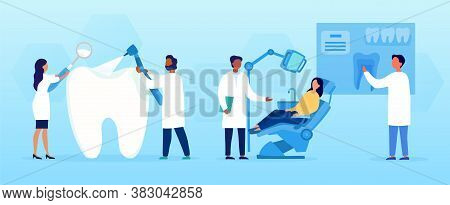 Dentistry Concept With Tooth Treatments Showing Two Dental Assistants Attending To A Large Tooth And