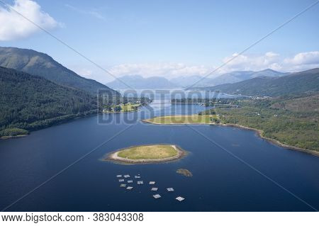 Loch Leven Aerial View Showing Ballachulish Bridge And Fish Farm Nets In Glencoe Scotland