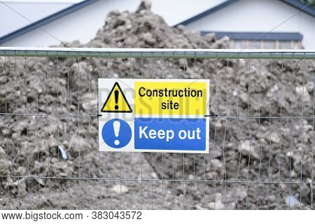 Construction Site Health And Safety Keep Out Sign On Fence Boundary