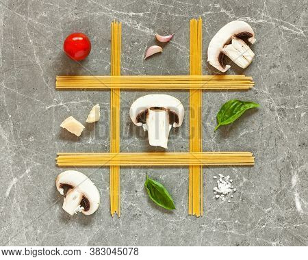 Creative Image For National Spaghetti Day. Tic Tac Toe Made Of Pasta, Mushrooms, Cherry, Basil And G