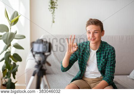 Cute Teen Guy Showing Okay While Shooting Video For His Blog, Home Interior, Copy Space