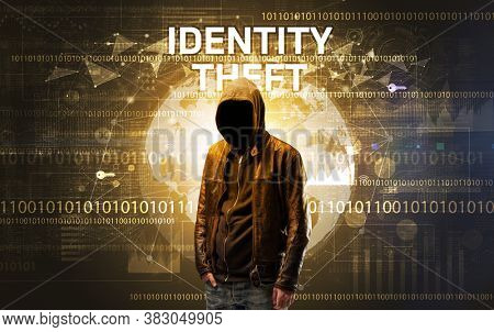Faceless hacker at work with IDENTITY THEFT inscription, Computer security concept