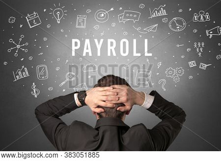 Rear view of a businessman with PAYROLL inscription, modern business concept