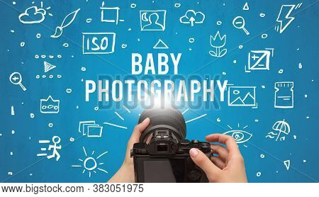 Hand taking picture with digital camera and BABY PHOTOGRAPHY inscription, camera settings concept