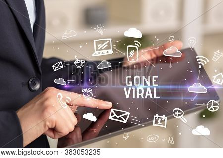 Close-up Of A Person Using Social Networking with GONE VIRAL inscription
