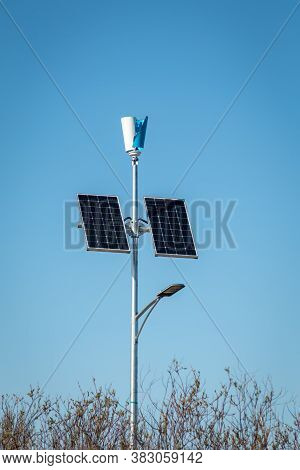 Solar Panels And Wind Generator On A Lighting Pole