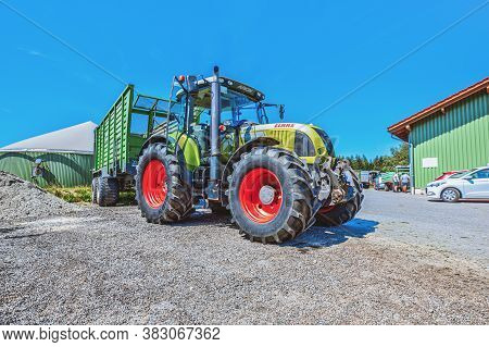 Bavaria / Germany - August 20, 2020: Claas Tractor With A Loader Wagon, Working On A Biogas Plant