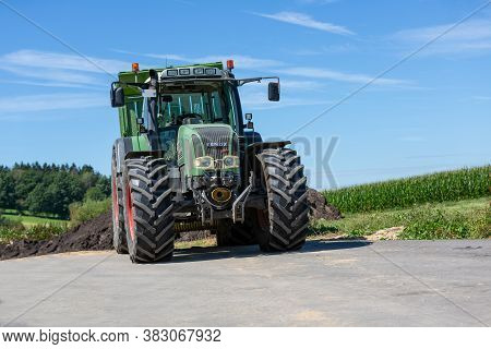 Bavaria / Germany - August 20, 2020: Fendt Tractor With A Loader Wagon, Working On A Biogas Plant