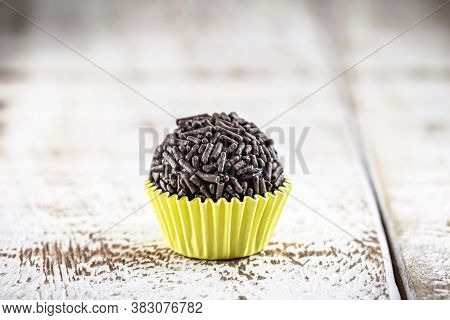 Brigadeiro (or Negrinho), A Brazilian Chocolate Candy Common At Children's Parties, On Wooden Table