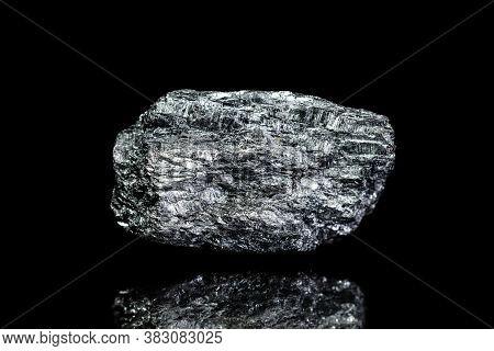 Manganese Ore, Raw Rock On Black Background, Mining And Geology, Mineralogy