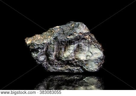 Stannite, Tin And Copper Iron Ore, Raw Rock On Black Background, Mining And Geology, Mineralogy