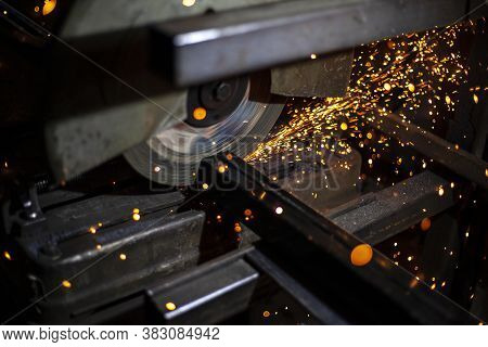 Metal Processing In The Workshop. Grinding Metal. The Worker Makes The Structure Of A Metal Profile.