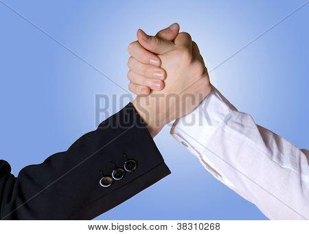 rivalry/handshake between business hands