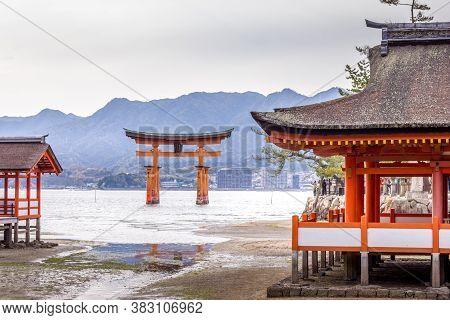 Floating Gate Of Itsukushima Shrine In Miyajima Island, Hiroshima, Japan (gate Sign Reads Itsukushim