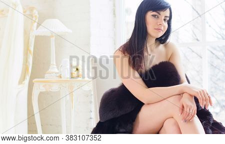 Attractive Lady With Sweet Figure Posing At Home Interior. Lady Wearing Sensual Lingerie. Seductive