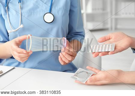 Female Gynecologist And Patient With Different Contraceptives In Clinic