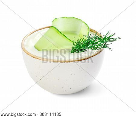 Delicious Yogurt Sauce With Cucumber In Bowl On White Background
