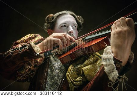 Playing Violin. Young Man As Johann Bach Isolated On Dark Green Background. Retro Style, Comparison