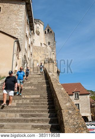 Rocamadour, France - September 3, 2018: People On Steep Steps Big Stairs At Pilgrimage Town Of Rocam