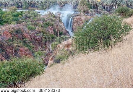 Part Of The Epupa Waterfalls In The Kunene River After Sunset. Baobab And Makalani Palm Trees Are Vi