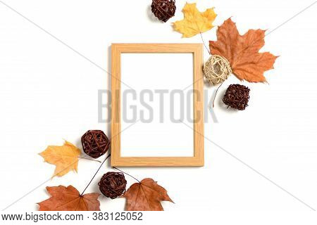 Photo Frame Mockup With Frame Made From Dry Maple Leaves And Rattan Balls On White Background