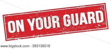 On Your Guard Text On Red Grungy Rectangle Stamp.