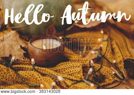 Hello Autumn, Hand Written  Text On Background Of Pumpkin, Autumn Leaves, Candle, Warm Lights On Yel