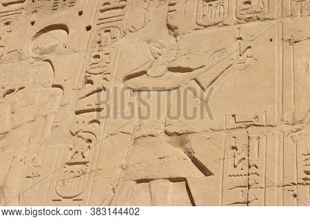 Ancient Egyptian Paintings And Hieroglyphs On The Wall In Karnak Temple Complex In Luxor, Egypt