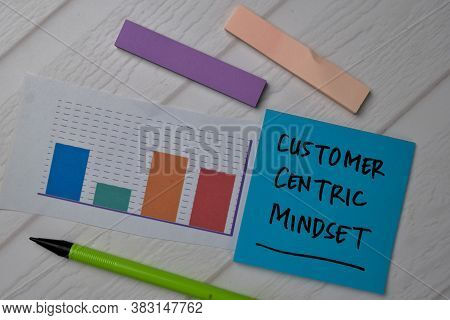 Customer Centric Mindset Write On Sticky Notes With Graphic On The Paper Isolated On Office Desk.