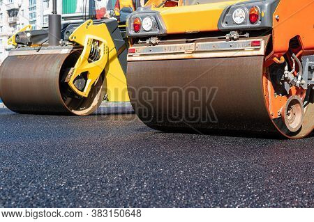 The Roller Flattens The Asphalt Tar, Paving The New Asphalt