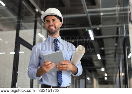 Shot Of A Engineer Using A Digital Tablet On A Construction Site.