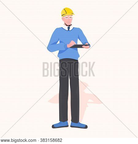 Architect Builder In Helmet Using Tablet Pc Civil Engineer Working At Construction Site Repair Servi