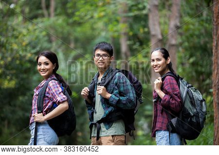 Asian Group Of Young People Hiking With Friends Backpacks Walking Together And Looking Map And Takin