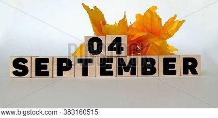 September 4 .september 4 On Wooden Cubes On A White Background.autumn Leave .calendar For September.
