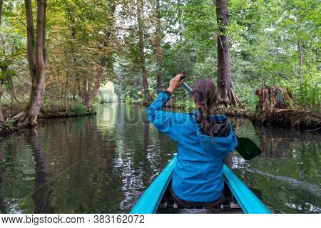 A Female Kayaker Enjoys Paddling Through The Channels And Canals O The Spreewald Region In Germany
