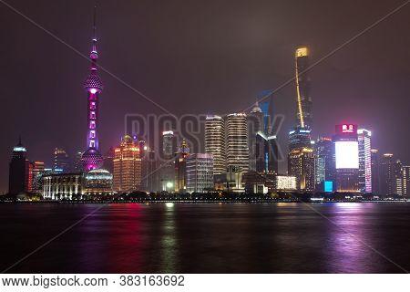February 2019, Shangahi. Panorama Of The City From The Bund On A Rainy Evening