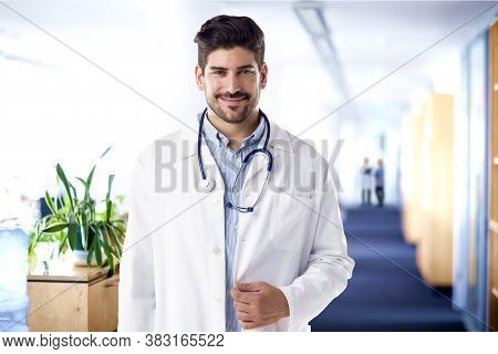 Male Doctor Portrait While Standing On The Clinic's Foyer