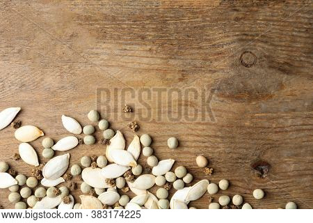 Mixed Vegetable Seeds On Wooden Background, Flat Lay. Space For Text