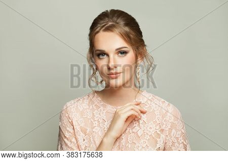 Attractive Woman With Fashionable Hairdo And Pastel Makeup On White Background