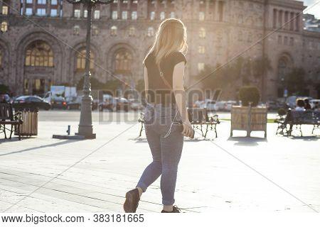 The Girl Walks Around The City Summer Mood.