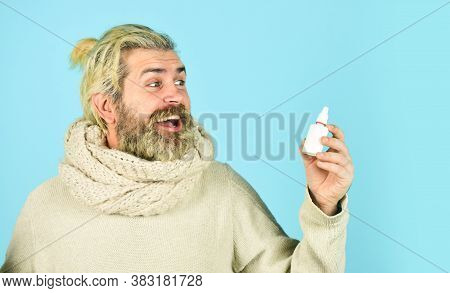 Happy Man Hold Nasal Drops. It Helps. Flu Concept. Hipster Feels Badly Ill Sneezing. Effective Nasal