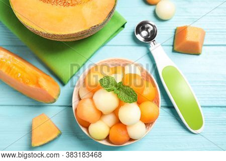 Melon Balls And Mint In Bowl On Light Blue Table, Flat Lay