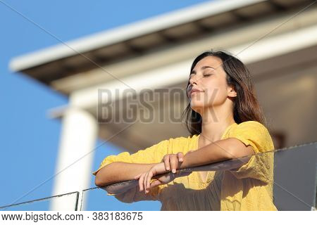 Apartment Renter With Closed Eyes Relaxing In A Balcony A Sunny Day