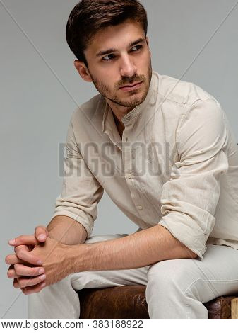 Handsome Man Wear Blue Shirt And Posing In Studio